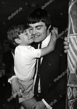 Drummer Jimmy Nicol, 24, is greeted by his four-year-old son, Howard, on his arrival at London Airport, England on from Melbourne. Jimmy stood-in for Beatles drummer Ringo Starr, unseen, during the first stages of the group's Australian tour