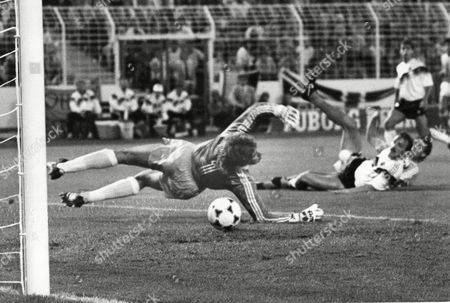 Holland's Marco van basten scores the second and decisive goal for his team in the 89th minute of the semi finals of the European Soccer Championships in Hamburg, West Germany, . The ball ball flies past German goalie Eike Immel, Juergen Kohler on the ground watches the scene. In the background Olaf Thon. The Netherlands beat West Germany 2-1
