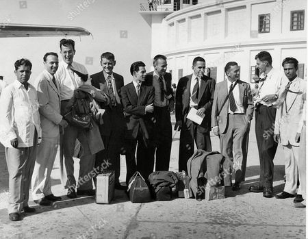 Stock Image of A seven-man U.S. Expedition to Mount Godwin Austin arrived in Karachi . From left to right are Dr. S.M. Ali (Education Ministry, Government of Pakistan); Robert H. Bates (American Embassy); George R. Bell, Peter Schoening, William White, Dee Molenaar, Arthur K. Gilkey, Dr. Charles S. Houston (Leader), Robert W. Craig (Foreign Ministry, Government of Pakistan