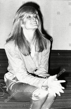 Farrah Fawcett sits at the Odeon Cinema at Londons Marble Arch, London, England. Farrah, the wife of televisions bionic man Lee Majors, is currently in Britain filming Saturn Three, a sci-fi drama in which she stars opposite Kirk Douglas