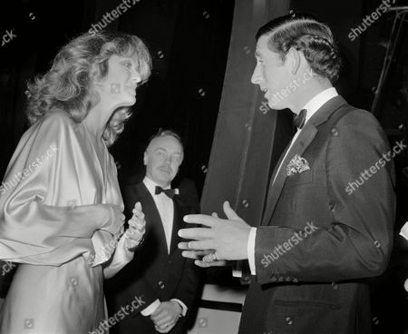 Britain's Prince Charles the Prince of Wales gestures as he chats with U.S. actress Farrah Fawcett Majors, after a Royal Gala charity performance at the London Palladium, . Farrah, who hosted the show, previously met the Prince when he visited Hollywood last October