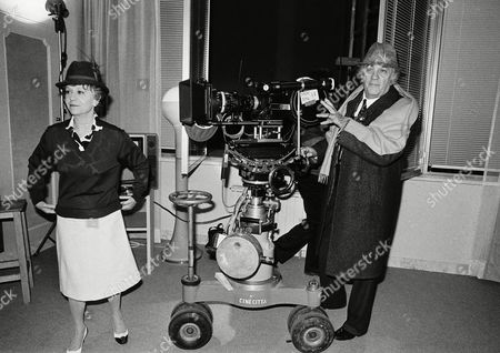 """Federico Fellini, Giulietta Masina Italian director Federico Fellini on the set of his new movie """"Fred and Ginger"""" currently being filmed at Rome's Cinecitta studio's, . At left his wife Giulietta Masina"""
