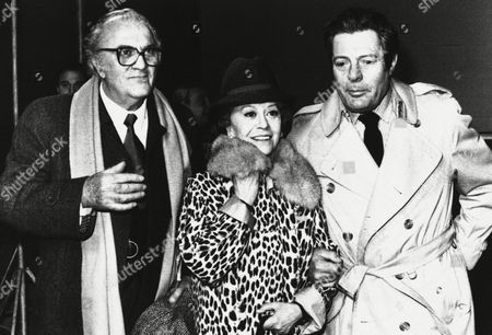 """Italian director Federico Fellini, his wife Giulietta Masina, and Italian actor Marcello Mastroianni after a press conference on in Rome on the set of Fellini's new movie """"Fred and Ginger"""" currently being filmed at Rome's Cinecitta studies"""