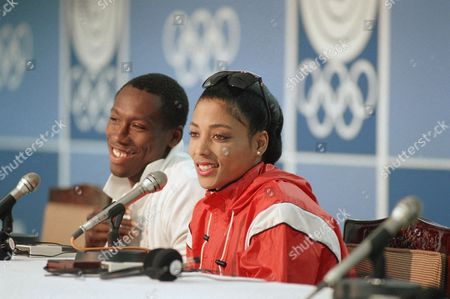 American Athletes Florence Griffith Joyner and her husband and coach, Al Joyner, in Seoul for the Olympic Games, smiles during a press conference