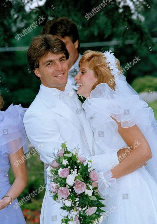 Doug Flutie, Laurie Fortier New Jersey Generals quarterback Doug Flutie embraces his new bride Laurie Fortier during their formal photo session following their wedding