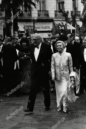 Italian film director Federico Fellini waves as he walks with his wife, Italian actress Giulietta Masina at the 27th International Film Festival in Cannes, France, on