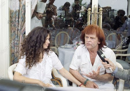 "German actor Klaus Kinski gives a press conference with his wife Deborah Kinski in Cannes, France on . She is also actress in his movie ""The Life"" or ""Kinski-Paganini"" which he directs in presentation in the 41st International Film Festival"