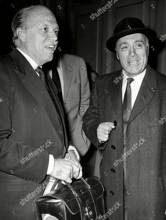 JOSHUA LOGAN; CHALES BOYER French actor Charles Boyer, right, arrives at the Saint-Lazare railway station in Paris, France, as film director Joshua Logan accompanies him. The two are to produce the film 'Cesar' a creation Marcel Pagnol