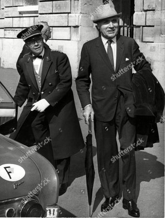 CHALES BOYER French actor Charles Boyer, right, is seen infront of the Hotel Crillon in Paris, France, as a footboy of the hotel opens a taxi door for him