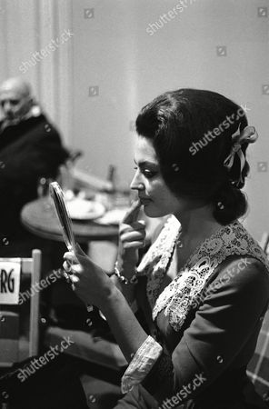 """Stock Photo of Acting Princess Ira von Fuerstenberg checks her lipstick while on set of the film """"J'ai tue Raspoutine"""" (""""I Killed Rasputin"""") directed by Robert Hossein at the Studios Eclair in Epinay-sur-Seine, France on where she plays the role of Princess Irina Yusupov"""