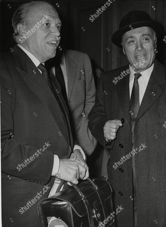 """Film director Joshua Logan, left, is pictured with French-American actor Charles Boyer as they meet at the Saint Lazare railway station in Paris,France, . The two are to film the movie""""Cesar"""", a creation of Marcel Pagnol"""