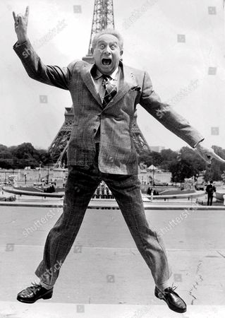 """Stock Photo of TRENET French singer and songwriter Charles Trenet, seen jumping in front of the Eiffel Tower, died Sunday evening, Feb. 18, 2001, at a Creteil hospital near Paris. He was 87. Trenet wrote nearly 1,000 songs that captured the hearts of the French for six decades, including """"La Mer"""" (The Sea) and """"Douce France"""" (Sweet France"""