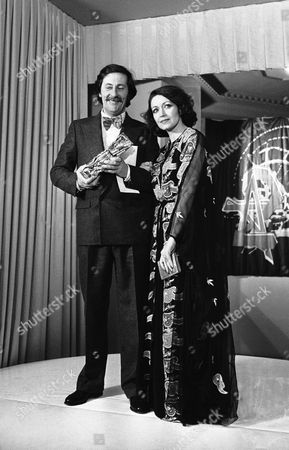 """French comedian Jean Rochefort poses with his """"Cesar"""" award received for his film """"Le Crabe Tambour"""" at the annual French cinema """"Cesars"""" ceremony, at the Pleyel Hall in Paris, France. Next to him stands French actress Francoise Fabian"""