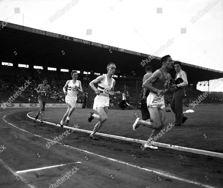 Alain Mimoun; Ahmed Ben Dali Labidi; Ahmed Labidi; Frank Sando; Fred Norris Alain Mimoun on his way to win the 10,000 meters event of the France versus England two-day meet at the Colombes Stadium in Paris, France on . Running from left to right are: Tunisian-born Ahmed Labidi running for France, Frank Sando and Fred Norris of Britain and Algerian-born French runner Alain Mimoun