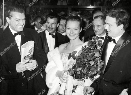 """Jean Marais, Marina Vlady; Jean-Francois Porron French actors, from left to right: Jean Marais, Marina Vlady and Jean-Francois Porron are all smiles at the premier of their movie """"La princesse de Cleves"""" (Princess of Cleves) directed by Jean Delannoy on at the cinema """"Le Colisee"""" in Paris, France"""