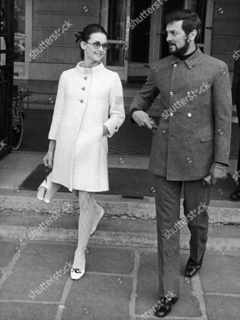 US actor Tony Curtis and his wife, German-born actress Christine Kaufmann are on their way to the United States coming from Italy and made a short stop over in Paris, France where they are seen here leaving the Crillon Hotel on