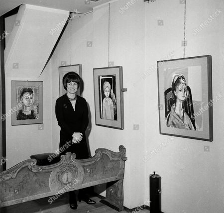 Francois Gilot, ex-wife of Pablo Picasso, poses with her own work at a personal art exhibition in Milan