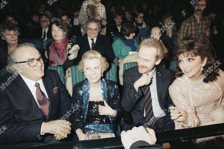 Italian director Federico Fellini, left, and Italian filmstar Gina Lollobrigida, right, at the opening ceremony of the 36th International Berlin Film Festival on . Gina Lollobrigida is the president of the international jury. Next to Fellini his wife Giulietta Masina and West Berlin's Senator of Cultural Affairs Volker Hassemer
