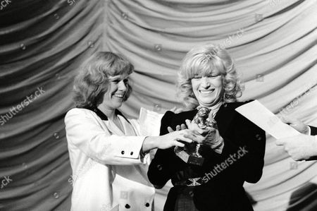"""Italian actress Monica Vitti (r) receives the """"Silver Bear"""" of the International Film Festival in Berlin, Germany,, for the Film """"Flirt"""" (Italy), directed by Roberto Russo. At left Jury President Norwegian actress, Liv Ullmann"""