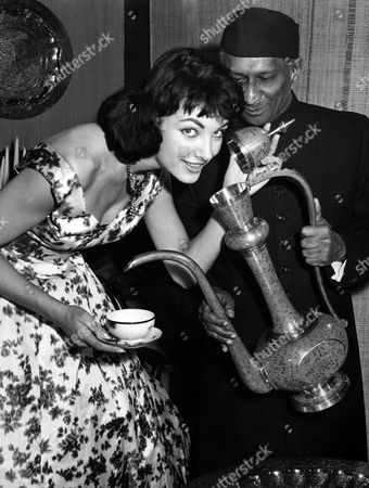 """Petra Schuermann; S.E.S.P. Wickramasinha Petra Schuermann of Germany, who won the """"Miss World"""" contest in London is named """"German Tea Princess"""" by Ceylon minister S.E.S.P. Wickramasinha, left, on October 30, 1957 in Bonn, Germany"""