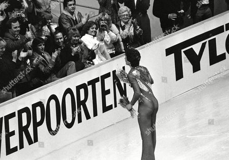 Norbert Schramm of West Germany acknowledges the applause after he performed the free skating in the men's final competition at the European Figure Skating Championships in Dortmund, West Germany on . He won the gold medal followed by Czech Jozef Sabovcik placing 2nd and Soviet Alexander Fadeev placing 3rd