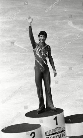Gold medal winner Norbert Schramm from Germany waves from the podium during men's winning ceremony at the European Figure Skating Championships in Dortmund, West Germany on