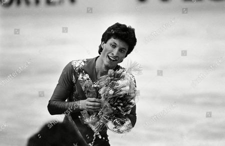 Norbert Schramm of West Germany holds a bunch of flowers after he performed the free skating in the men's final competition at the European Figure Skating Championships in Dortmund, West Germany on . He won the gold medal followed by Czech Jozef Sabovcik placing 2nd and Soviet Alexander Fadeev placing 3rd