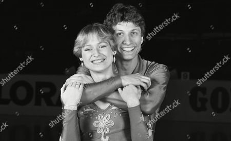 Norbert Schramm, European figure skating champion from West Germany, shares a smile on while embracing his countrywoman Claudia Leistner, who won the bronze medal in the ladies competition at the European Figure Skating Championships in Dortmund, West Germany