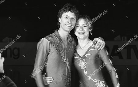 Norbert Schramm, European figure skating champion from West Germany, shares a smile on with his countrywoman Claudia Leistner, who displays the bronze medal she won in the ladies competition at the European Figure Skating Championships in Dortmund, West Germany