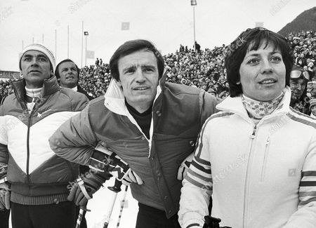Four former World Champions and Olympic gold medalists, who share nineteen world championship titles among themselves met during the opening ceremonies for the 25 th Alpine World Championships in Garmisch, West Germany on . From left to right are: Karl Schranz (Austria 3 titles), Toni Sailer (Austria 7 titles), Jean Claude Killy (France 6 titles), Rosi Mittermaier (Germany 3 titles). They participated in exhibition skiing during the ceremonies