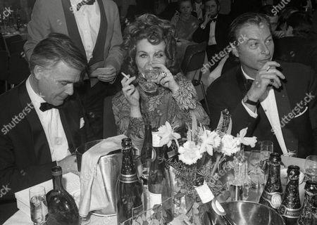 JOACHIM FUCHSBERGER; GUNDULA KORTE; LEX BARKER German actor Joachim Fuchsberger, left, his wife Gundula Korte, center, and Lex Barker at the Film Ball in Mainz, Germany