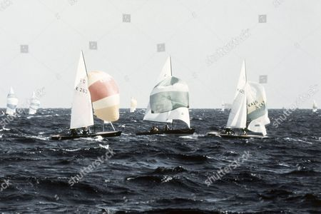 Stock Image of Competing in the fourth race of the Summer Olympic Games sailing/yachting event in the Flying Dutchman class on at the Schilksee in Kiel, Germany are from left, K 263, Great Britain (Rodney Pattisson, Christopher Davies); IR 1, Ireland (Harold Cudmore, Richard O'Shea) and KA 255, Australia (Mark Bethwaite, Timothy Alexander). British boat K 263 leads after four races
