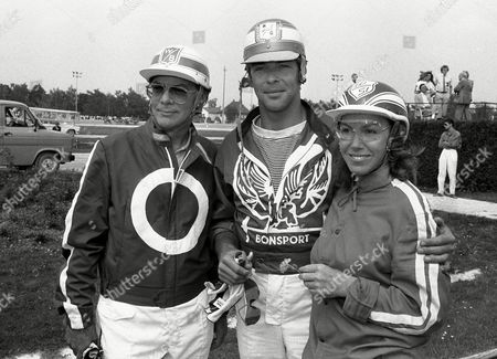 """Actors of the German TV series """"Schwarzwaldklinik"""" (Black Forest Clinic) from left: Klaus-Juergen Wussow, Sascha Hehn and Gaby Dohm stand in the sulky at the harness racing track in Munich-Daglfing, Munich, West Germany, . The actors encourage the public here to give donations to support children having cancer and help them pay their treatments. 50,000 German Marks (25,000 US Dollars). Wussow is famous for his role as Dr. Brinkmann in the German TV series """"Schwarzwaldklinik"""" (Black Forest Clinic"""
