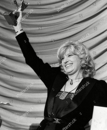 MONICA VITTI Italian actress Monica Vitti presents the 'Silver Bear' she was awarded with at the Film Festival in Berlin 'Berlinale', Tuesday night for her film 'Flirt' directed by Roberto Russo