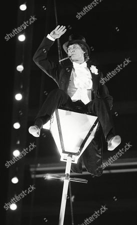"""German figure skating champion Norbert Schramm, balances on Fattinis lantern during the charity TV show """"Stars in der Manege"""" (Stars at the Circus) in the Circus Krone tent in Munich, Germany on . Proceeds will go towards funds for artists and journalists"""