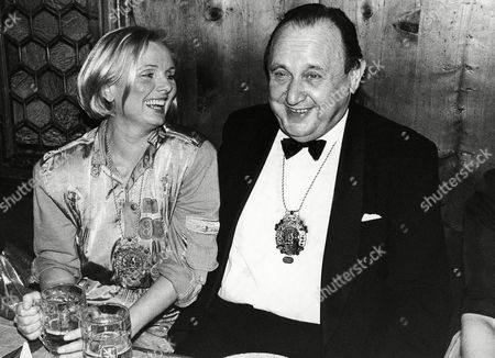 German actress Ruth Maria Kubitscheck, left, and German Foreign Minister Hans-Dietrich Genscher share a laugh while drinking beer on at the Bayerischer Hof in Munich, Germany