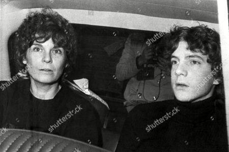 Former actress Gail Harris arrives in a police car with her son John Paul Getty III at police headquarters in Rome, . Getty, teenage grandson of the U.S. oil tycoon, was finally released after six months yesterday by his Italian kidnappers. At one point the kidnappers cut off his ear and mailed it to further their demand for the $750,000 ransom