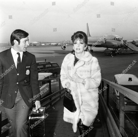 """Gina Lollobrigida Italian actress Gina Lollobrigida, who announced her forthcoming marriage to New York realtor George Kaufman, returned to Rome, for film commitments which will keep her busy until wedding day. She told newsmen that the wedding day date has been set for December 18 in New York. The actress added she is busy both in Rome and St. Moritz, Switzerland in a new film in which she is acting entitled """"No Job"""