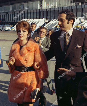 Stock Image of Gina Lollobridiga and her fiance, George Kaufman at Rome airport before departing for New York