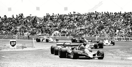USA racing driver Mario Andretti in his John Player Lotus MK IV leads as he drives to victory in 1978 Grand Prix of France Sunday afternoon. Following Andretti No. 2 J. Watson, No. 1 Niki Lauda and No. 6 Ronnie Peterson