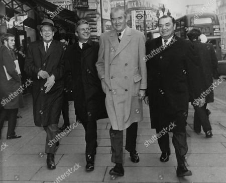 "Stock Picture of Dan Duryea, Hardy Krueger, James Stewart and Ernest Borgnine, stroll at Piccadilly, London, England, after giving a press interview for the upcoming premiere of their movie ""The Flight of the Phoenix"", January 20"