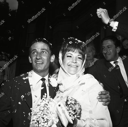 British Jazz singer Annie Ross, who made her name singing with the Count Basie Band in the United States, and actor Sean Lynch are covered with confetti as they leave Paddington Registry Office, London, United Kingdom, after their marriage