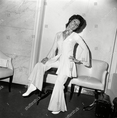 Television and stage actress Carole Ann Ford strikes an attractive pose wearing a trouser suit in peach Crepe de Chine at London's Savoy Hotel, United Kingdom,, where she was attending the 16th Women of the Year Luncheon, in aid of the Greater London Fund of the Blind