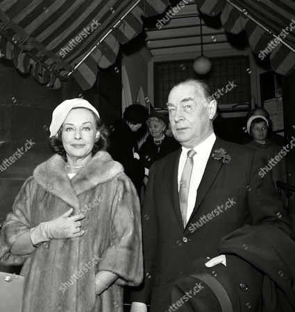 American actress Paulette Goddard and her husband, German author Erich-Maria Remarque, are pictured as they leave the church of St. Mary in Chelsea, London, United Kingdom,, after attending the wedding of Count Vicenzo Visconti Prasca of Italy, and the former Mrs. James Jackson Cabot, daughter of the late Captain William Rush of the United States Navy