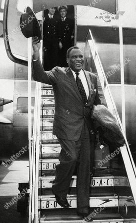 Paul Robeson, the Negro singer, arrives at London airport, United Kingdom,, from the United States - with the passport he obtained after an eight-year struggle. Robeson, a supporter of communist-front causes and a winner of the Stalin Peace Prize, was denied a passport by the U.S. because he repeatedly refused to sign a non-communist affidavit which the state department required before issuing a passport. A Supreme Court decision outlawed the requirement. The singer plans a series of concerts in Europe. His program includes performances in Prague and the Soviet Union. He said he will receive 1,000 pounds (2,800 dollars) for his first performance in London