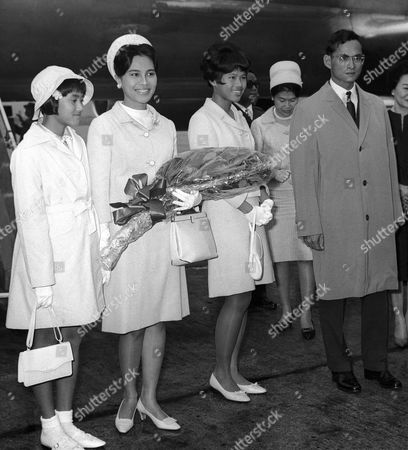 The King and Queen of Thailand and two of their three daughters, Princess Sirindhorn, 11, left, and Princess Ubol Ratana, 15, centre, at London Airport on after they flew in for a ten-week private visit. During the visit the King and Queen will visit their 14-year-old son, Prince Vajiralongkorn, who attends Kings Head Preparatory School in Seaford, Essex, United Kingdom. Their youngest daughter, Princess Chulabhorn, 9, was taken from the airliner to a private house at Sunninghill Berkshire, after being taken ill on the flight