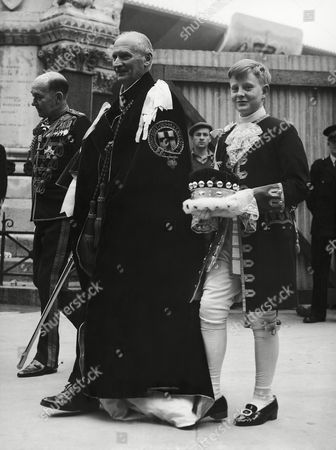 Lord Montgomery leaves with his page Nicholas Wright on Westminster Abbey in London, United Kingdom after the final rehearsal of the coronation ceremony