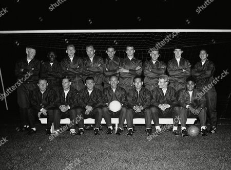 Sixteen members of the rest of the world soccer team to play England at Wembley, pictured at night at the White City Stadium in London, United Kingdom on Monday, Oct. 21, 1963, before a training session. Standing left to right are: Karl Heinz Schnellinger, Germany; Djalma Santos, Brazil; Svatopluk Pluskal, Czechoslovakia; Popluhar, Czechoslovakia; Lev Yashin, USSR; Milutin Soskic, Yugoslavia; Josef Masopust, Czechoslovakia; Jim Baxter, Scotland; Luis Eyzaguirre, Chile. Seated left to right are: Uwe Seeler, Germany; Raymond Kopa, France; Ferenc Puskas, Hungary; Alfredo Di Stefano, captain, Spain; Francisco Gento, Spain; Denis Law, Scotland; Silva Da Eusebio, Portugal