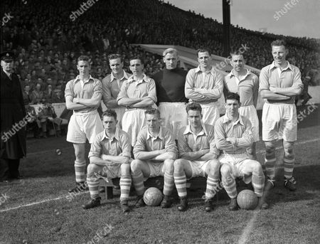 Billy McAdams; Don Revie; Ken Barnes; Bert Trautmann; Jimmy Meadows; Roy Paul; Dave Ewing; Paddy Fagan; Roy Little; Johnny Hart; Royston Clarke Members of the Manchester City football team pose on at an undisclosed location. Standing on the pitch, back row, from left to right are: Billy McAdams, Don Revie, Ken Barnes, Bert Trautmann, Jimmy Meadows, Roy Paul and Dave Ewing. Front row from left to right: Paddy Fagan, Roy Little, Johnny Hart and Royston (Roy) Clarke