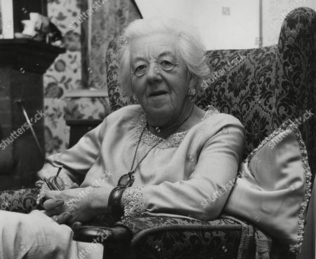 74-year-old British actress Dame Margaret Rutherford is pictured sitting in an armchair at her home in Gerrads Cross, Buckinghamshire, England